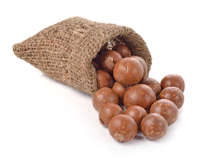 Macadamia nuts in the bag on white background royalty free stock photos