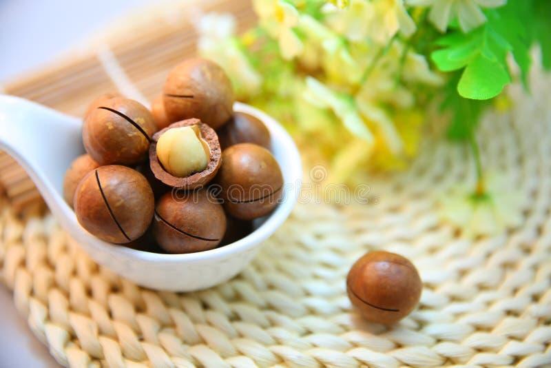 Macadamia nuts in bowl royalty free stock photos