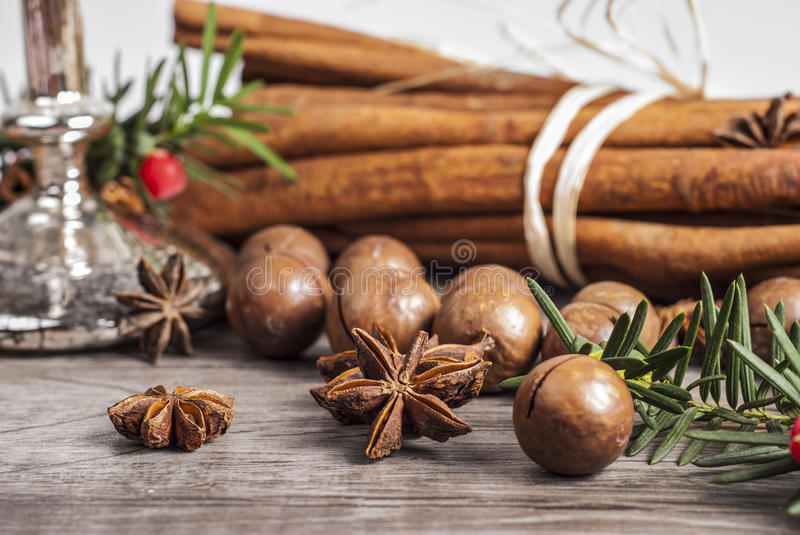 holiday decor with macadamia nuts and cinnamon royalty free stock photos