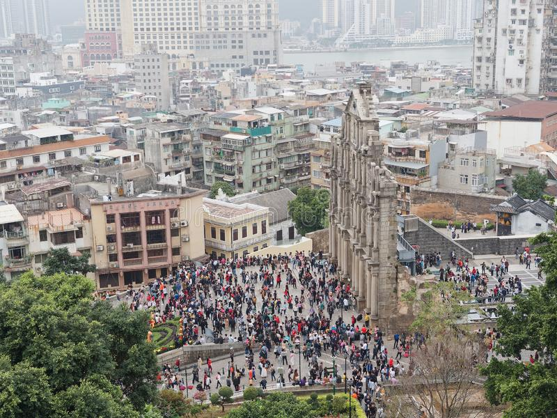 Macao, China - Feb. 9, 2019: Ruins of St. Paul, iconic Church facade and religious museum, crowd of people and tourists royalty free stock photo