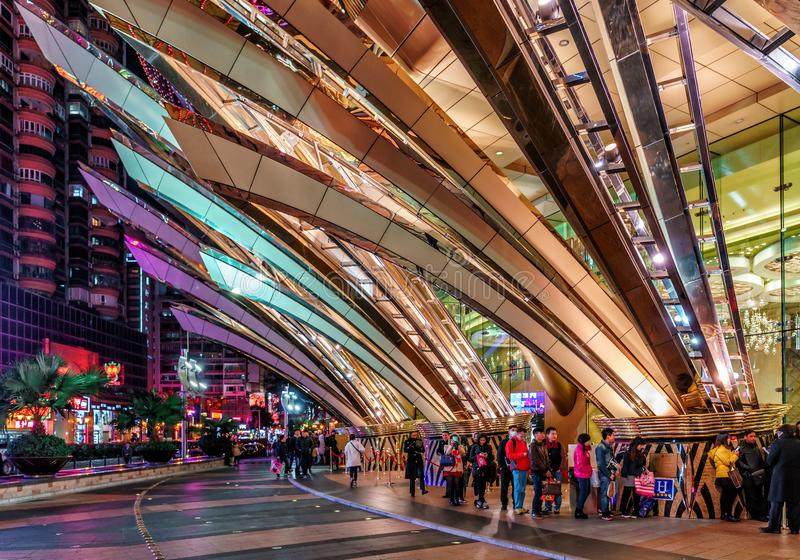Macao, China: Grand Lisboa Hotel and Casino in Macau has modern design. Exterior night view with architectural illumination royalty free stock images