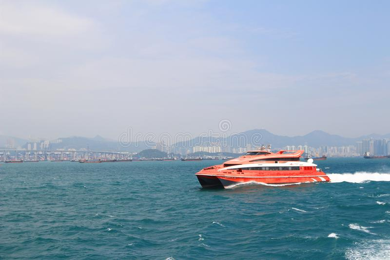 Macao to Hong Kong ferry boats in Hong Kong harbor. The Macao to Hong Kong ferry boats in Hong Kong harbor stock images