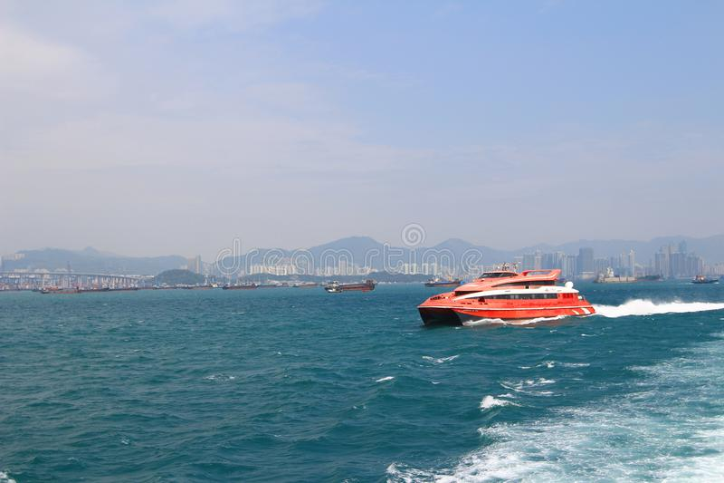 Macao to Hong Kong ferry boats in Hong Kong harbor. The Macao to Hong Kong ferry boats in Hong Kong harbor stock image