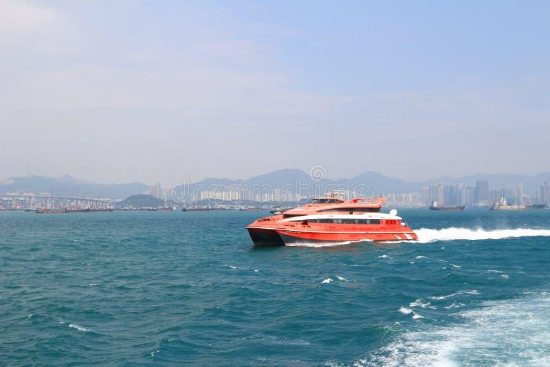 Macao to Hong Kong ferry boats in Hong Kong harbor. The Macao to Hong Kong ferry boats in Hong Kong harbor stock photo