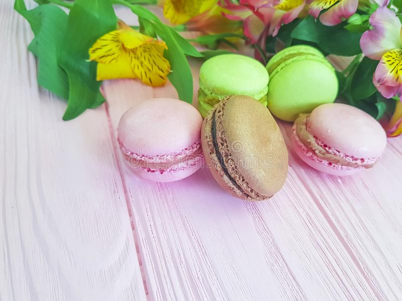 Macaron colorful pink wooden tasty background,cookie alstroemeria flower leaf royalty free stock image