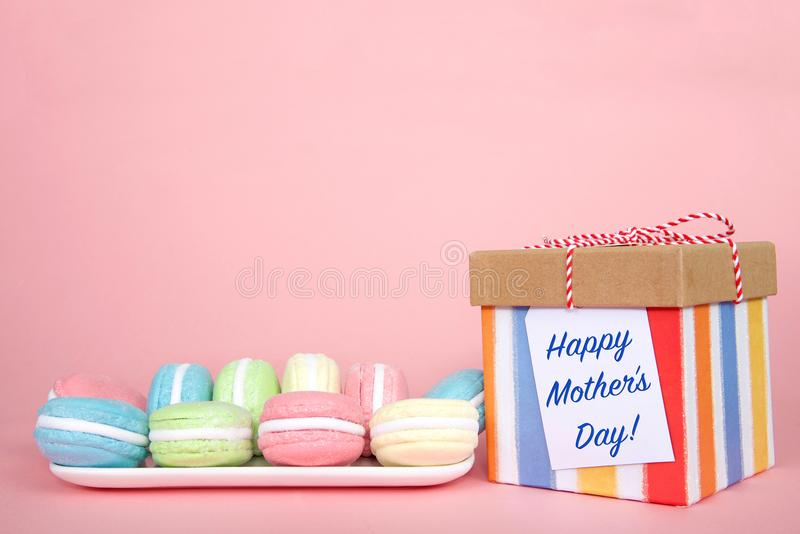Macaron Mother`s Day present on pink background stock images