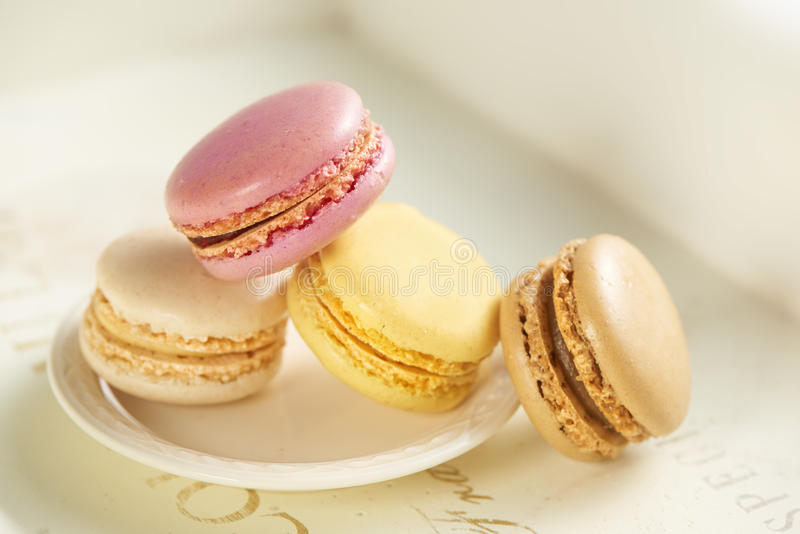 Macarones on a small white plate royalty free stock image