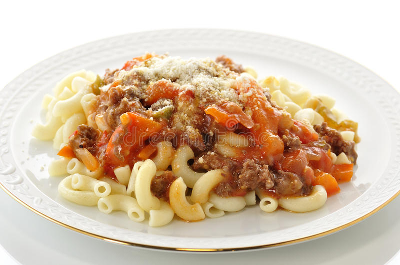 Macaroni. With sauce and vegetables royalty free stock photo