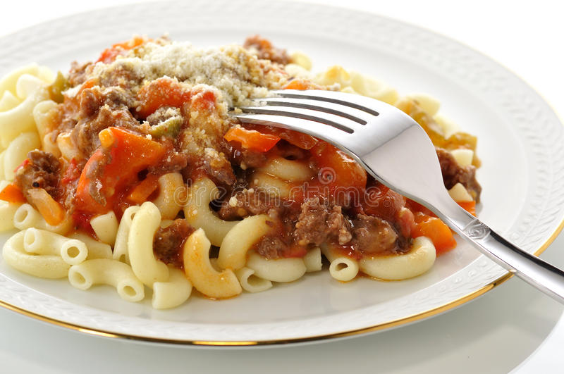 Macaroni. With sauce and vegetables royalty free stock images