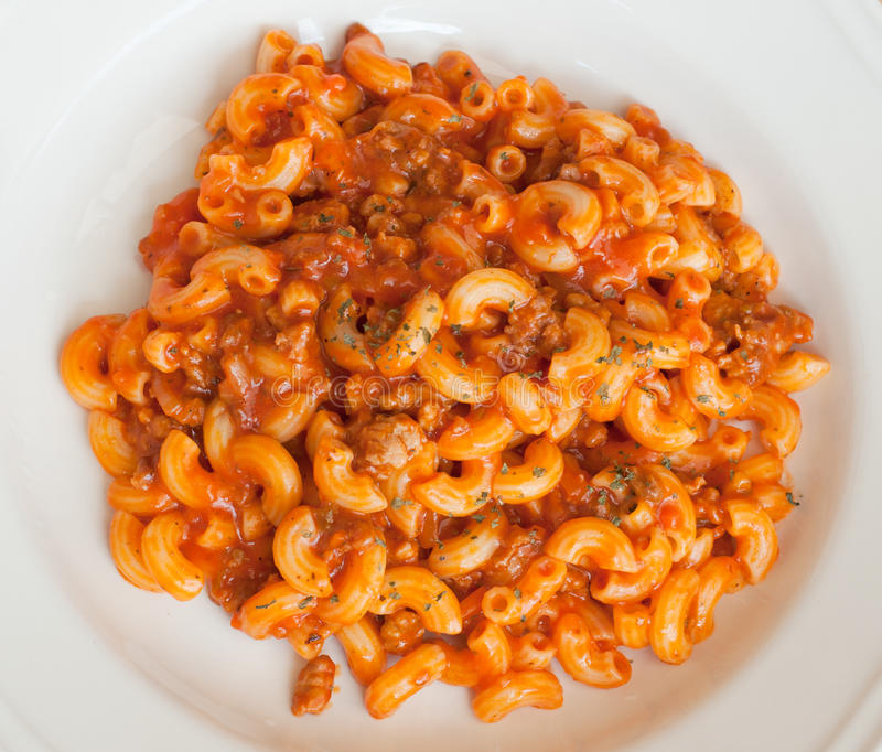 Macaroni and cheese. With tomato sauce, top view royalty free stock photo