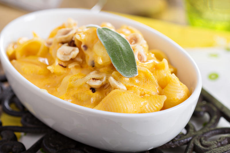 Macaroni and cheese with butternut squash. And sage stock images