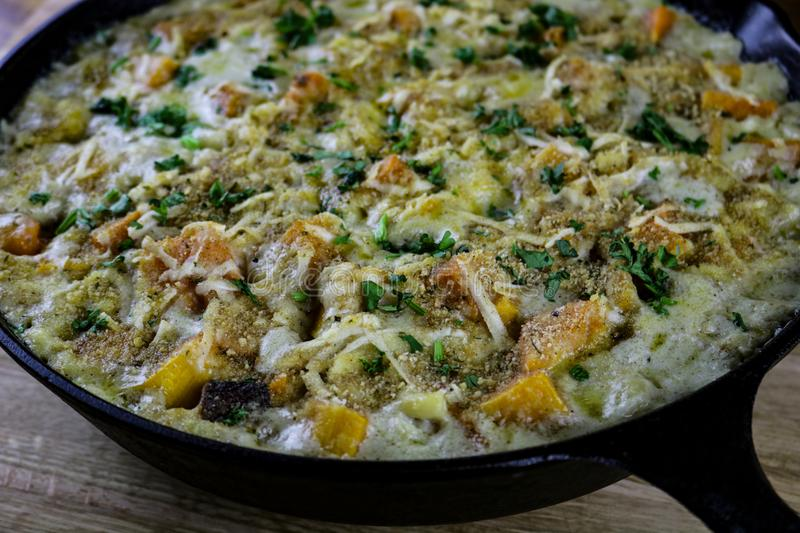 Macaroni and Cheese. With butternut squash prepared in a cast iron pan royalty free stock photo