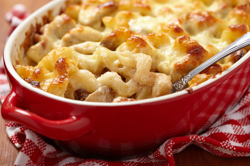 Macaroni with cheese, chicken and mushrooms royalty free stock image