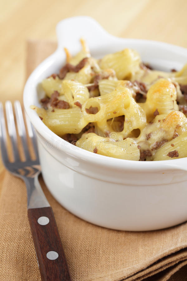 Macaroni and cheese with ground beef. In the white pot stock photos
