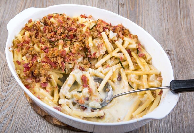 Macaroni and cheese with ham stock photo
