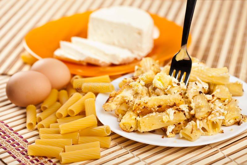 Macaroni with cheese and recipe ingredients royalty free stock photography
