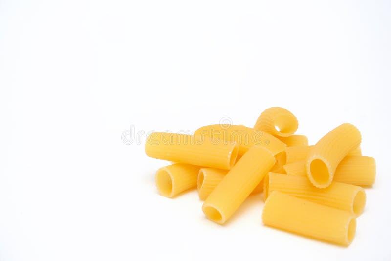 Macaroni isolated. Isolated group of italian macaroni on light background stock photography