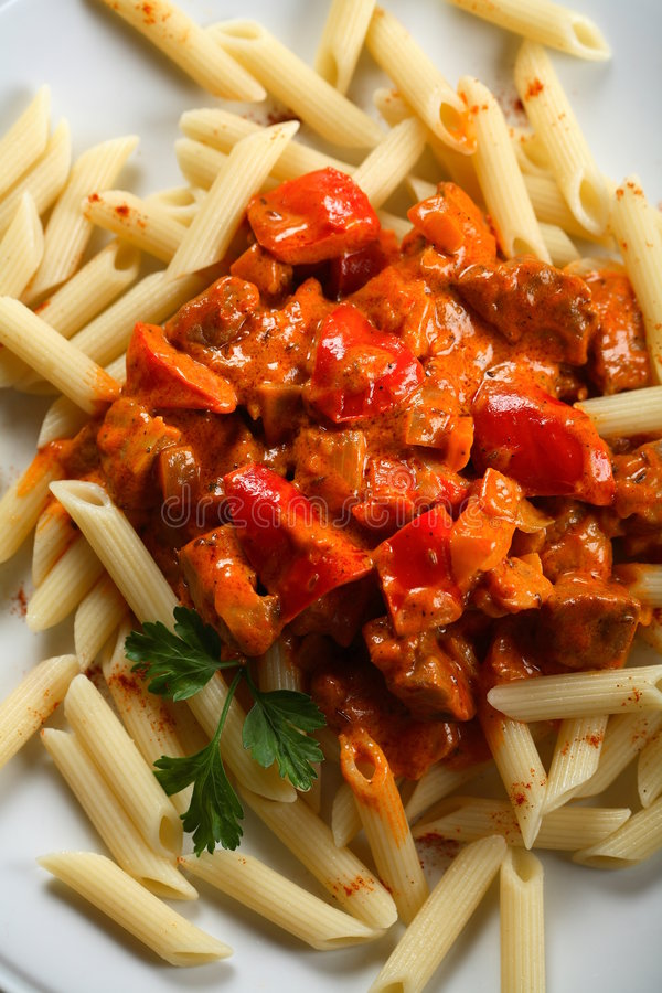 Macaroni with meat and pepper. Macaroni with oven meat and red pepper royalty free stock photography