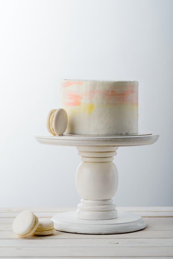Macaroni and minimalist cake royalty free stock photo