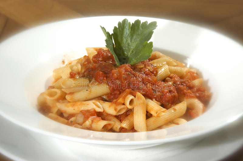 Macaroni Napolitana. W tomato sauce and parsley stock image