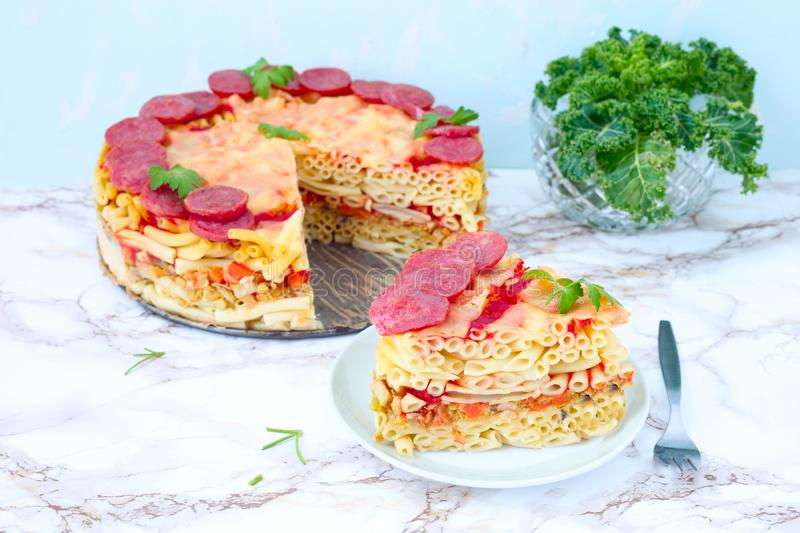 Macaroni pie. Baked macaroni pie with cheese and salami stock photography