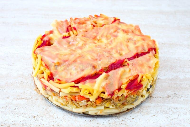 Macaroni pie. Whole baked macaroni pie with cheese royalty free stock photo
