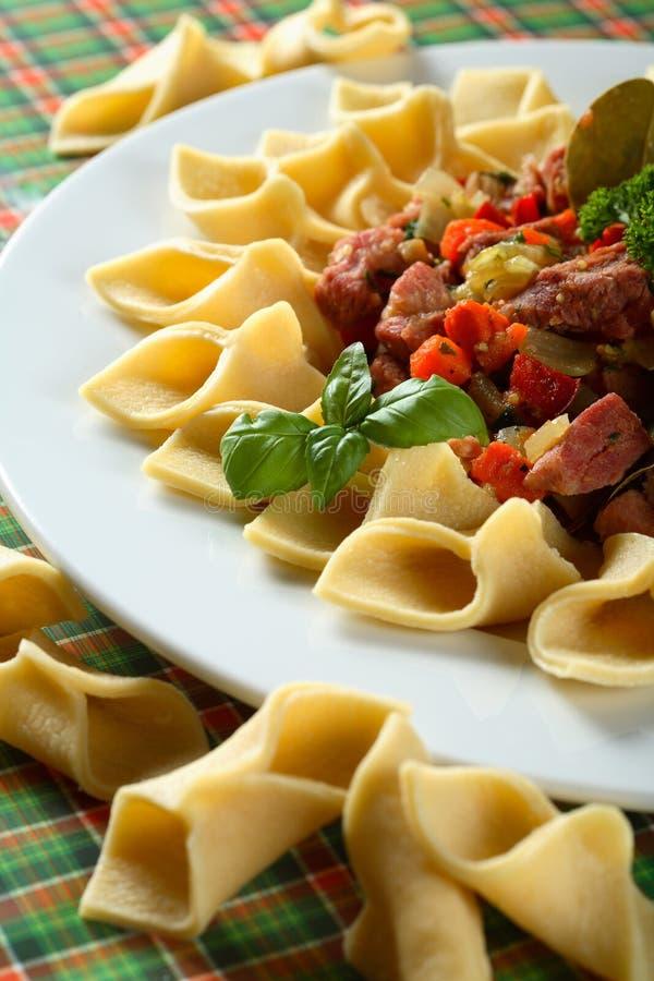 Macaroni with pork stock images