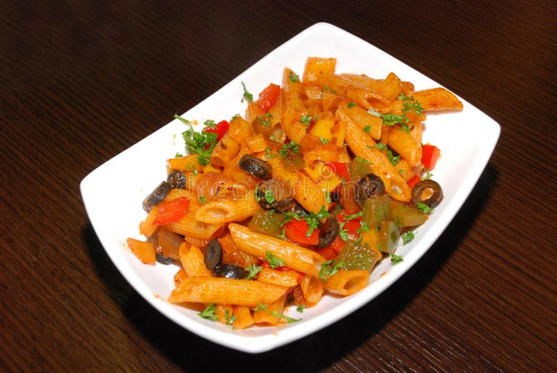 Macaroni with tomato paste royalty free stock photos