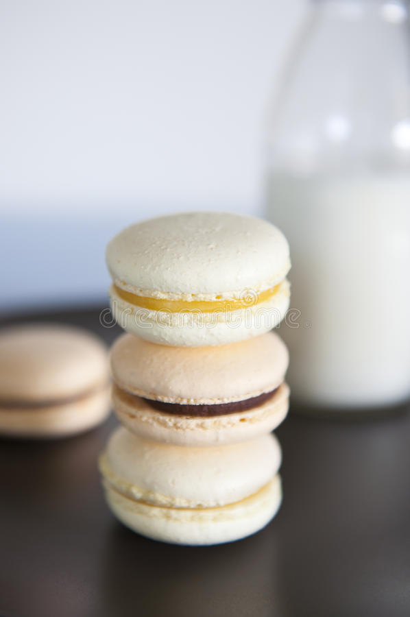 Macarons and milk royalty free stock image