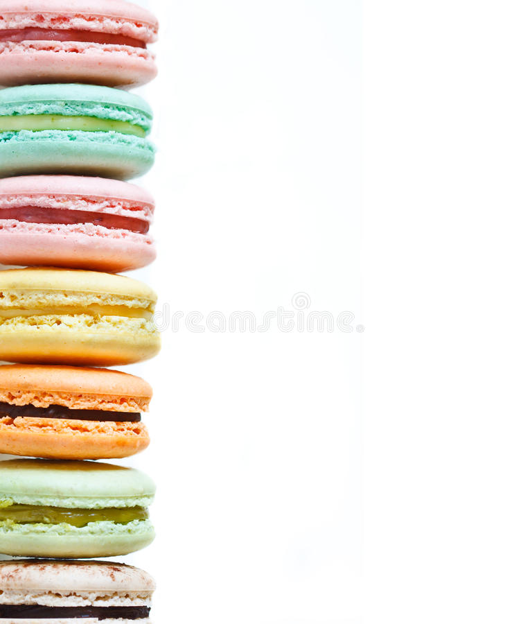Macarons. Pile of fresh macarons on a white background with copy space royalty free stock images