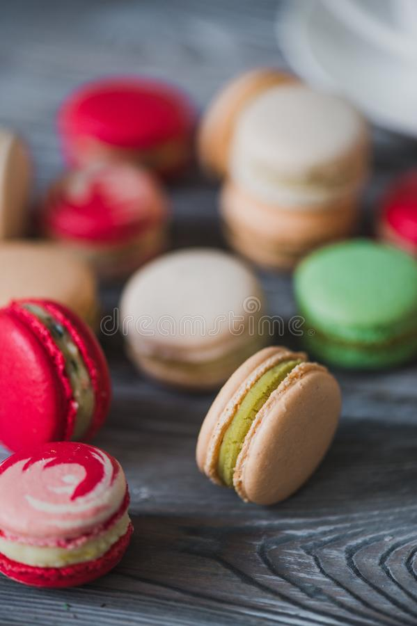 Macarons on rustic wood table, French candy meringue-based made with egg white, icing sugar, granulated sugar, almond royalty free stock photography