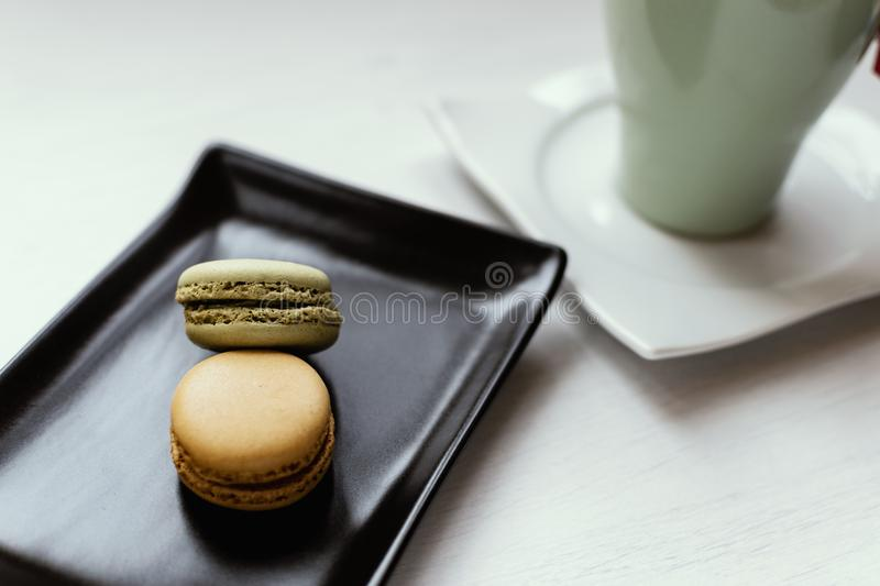 Macarons with tea. stock images
