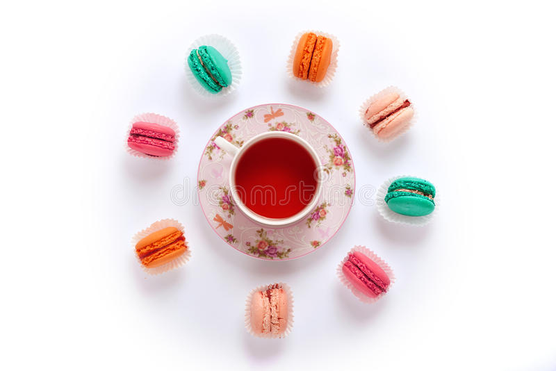 Macaroon circle and tea on a white background from above stock photography