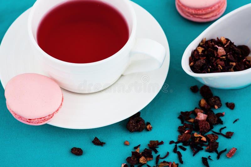 Macaroon and herbal tea stock image