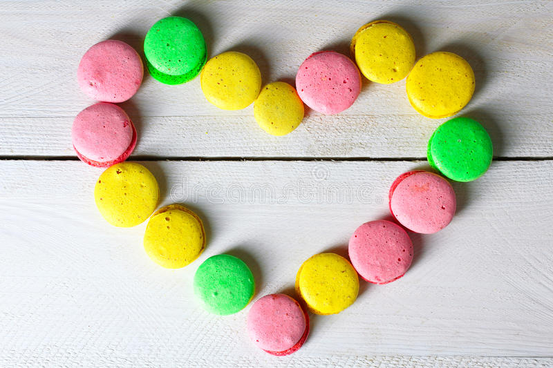Macaroon laid out in the shape of heart royalty free stock images