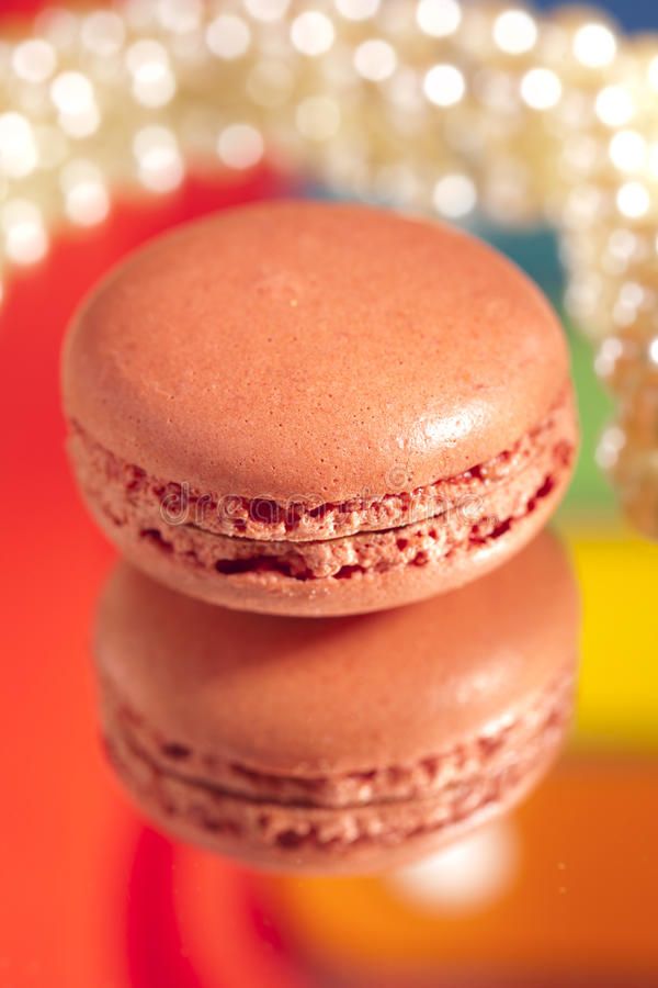 Macaroon red with its own reflection colorful royalty free stock photography