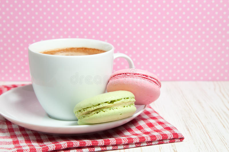 Macaroons and cup of coffee. Macaroons and one white cup of coffee stock photography