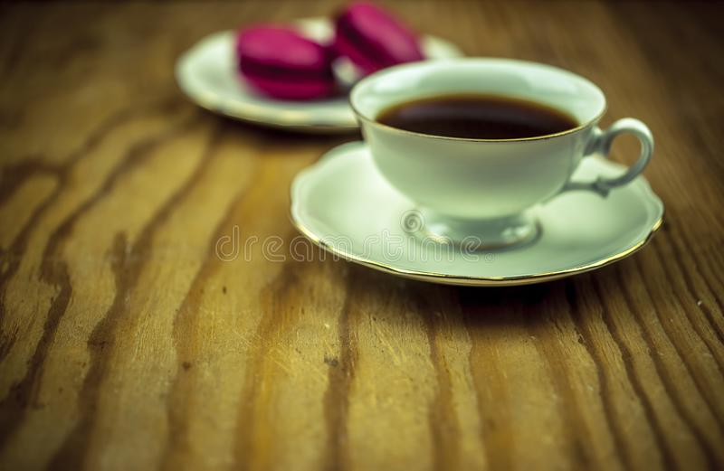 Macaroons with cup of coffee royalty free stock image