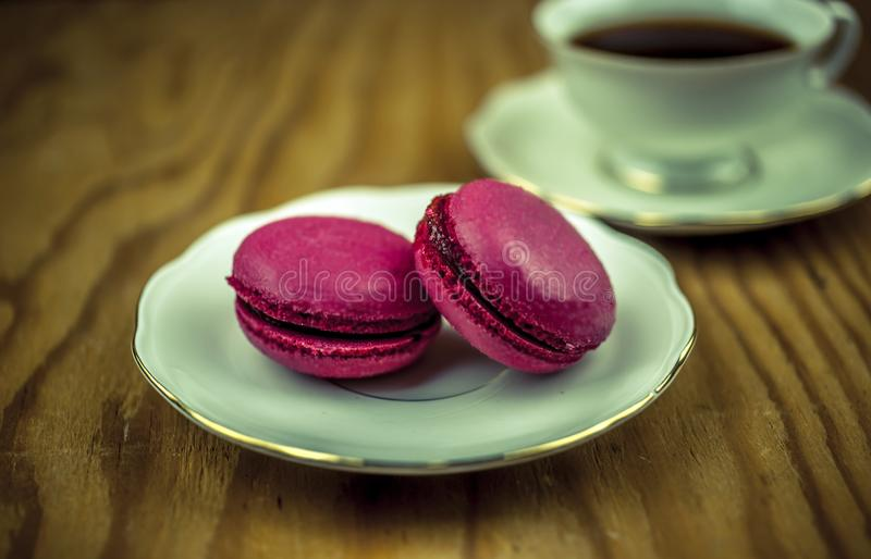 Macaroons with cup of coffee stock image