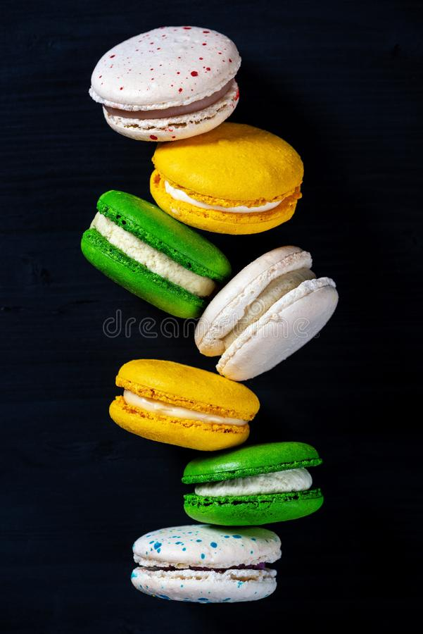 Macaroons on dark background, colorful french cookies macarons stock images