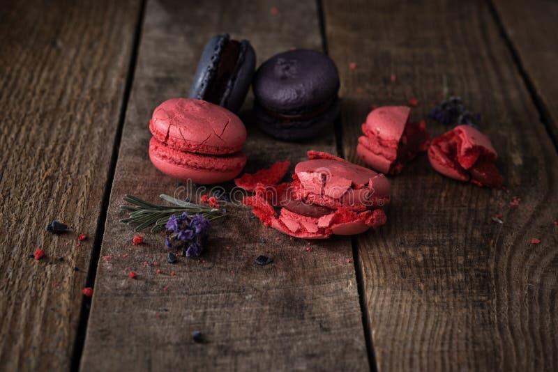 Macaroons on dark wooden background stock photo