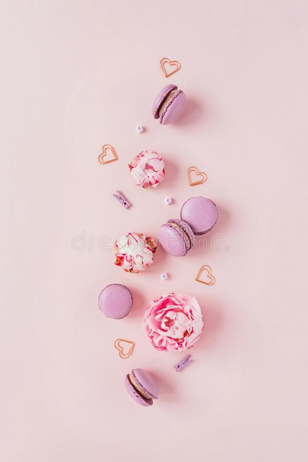 Macaroons and flowers on a pink background. royalty free stock image