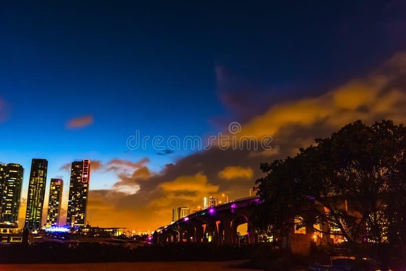 MacArthur causeway and downtown Miami Beach at night royalty free stock photos