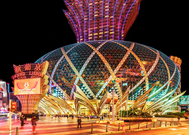 MACAU, CHINA. Grand Lisboa 5-star Hotel in Macau which is the gambling capital of Asia. Entrance view. Night Macao cityscape royalty free stock photo