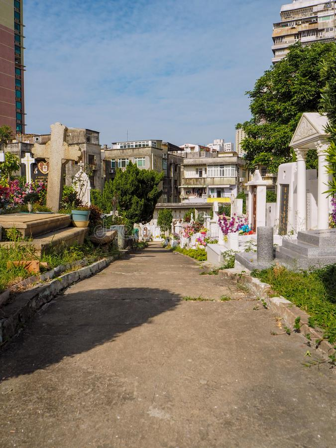 MACAU,CHINA - NOVEMBER 2018: The Saint Michael`s chapel and cemetery in the city center with graves of catholic Macau Portuguese royalty free stock images