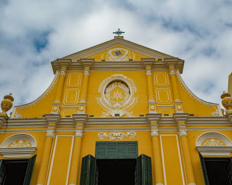 MACAU, CHINA - NOVEMBER 2018: Yellow facade with shutters of the St. Dominic`s church with Portuguese and Macanese features. In the city center stock image