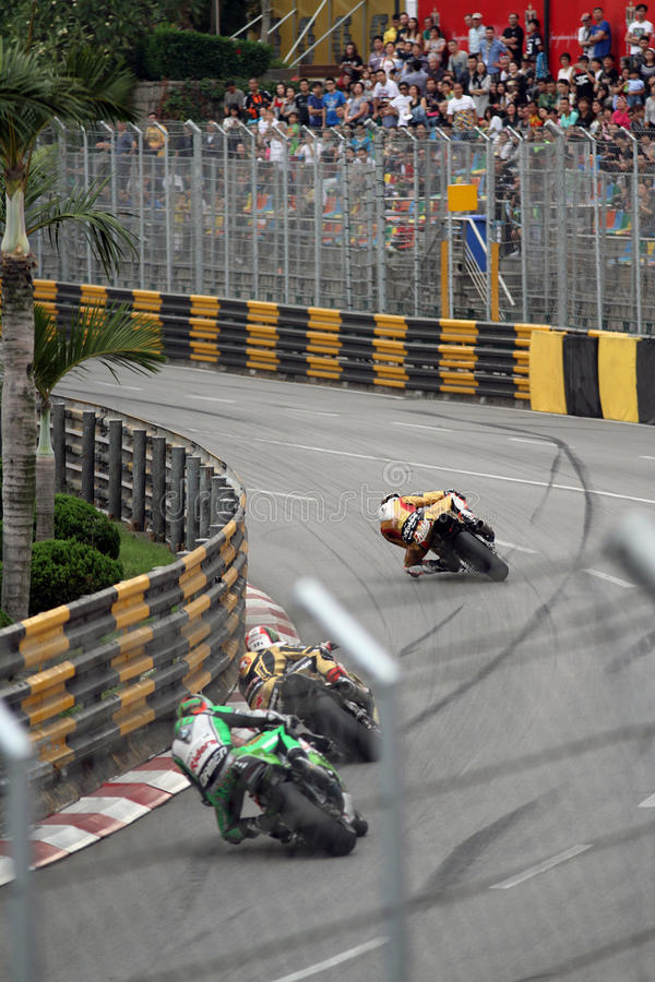 Macau GP with Peter Hickman, Michael Rutter at Reservoir bend and crowd in background. Kawasaki 1000rr against BMW S1000RR superbike motorcycles stock photos