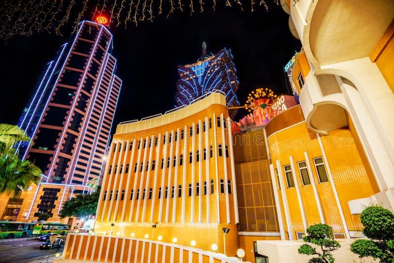 Macau - January 24, 2016: Grand Lisboa iconic casino hotel view. Night Macau cityscape royalty free stock images