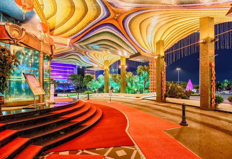 Macau - January 24, 2016: Iconic Grand Lisboa casino hotel. Entrance night view with lights royalty free stock photo