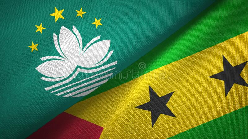 Macau and Sao Tome and Principe two flags textile cloth, fabric texture. Macau and Sao Tome and Principe two folded flags together stock photo